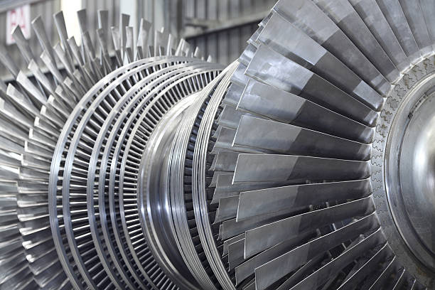 Rotor of a steam turbine Internal rotor of a steam Turbine at workshop turbine stock pictures, royalty-free photos & images