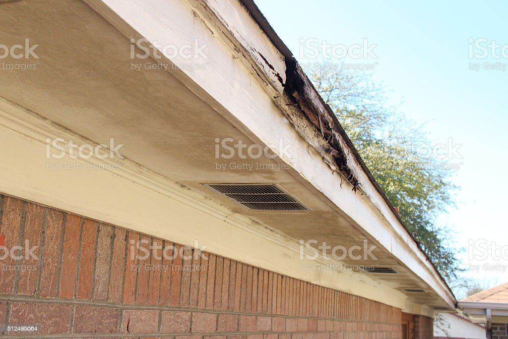 Rotted Wood House Eaves stock photo