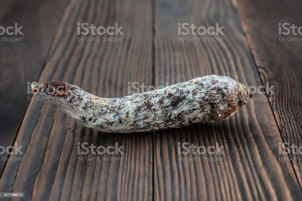 rotten and moldy carrot on a wooden background stock photo
