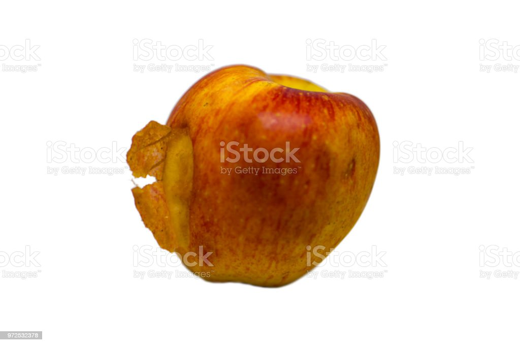 Rotten apple with pealing skin stock photo