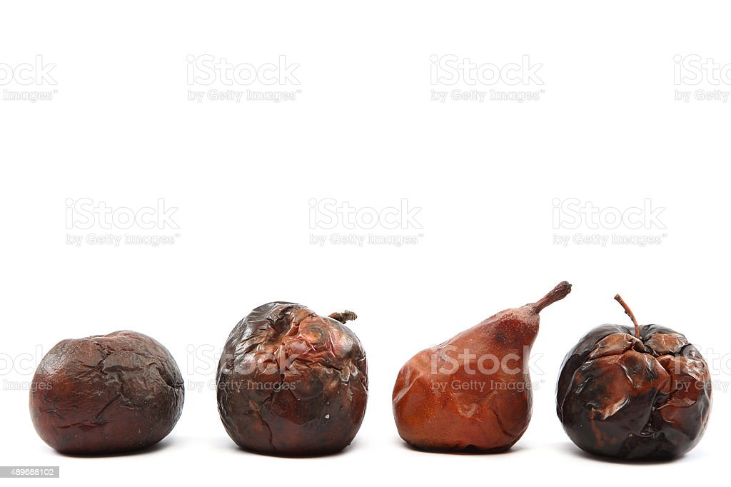 Rotten apples and pea on white background. stock photo