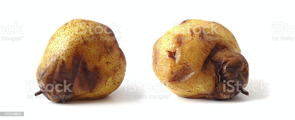 rotten pear in two positions royalty-free stock photo