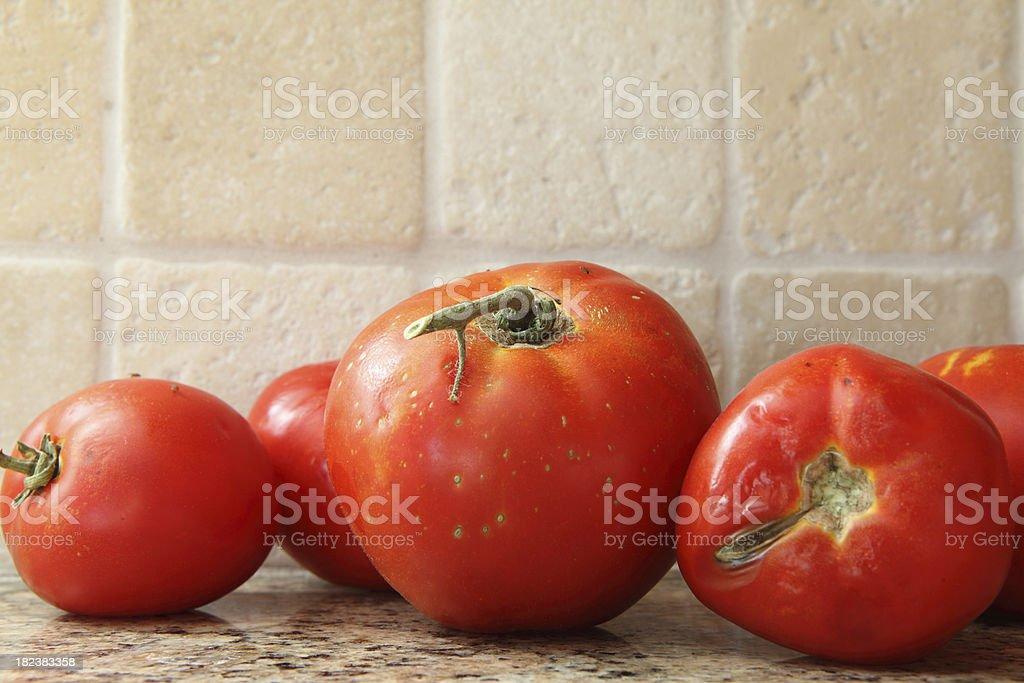 Rotten tomatoes on kitchen counter stock photo