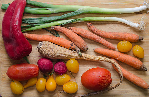 Rotten vegetables on a wooden background. Top view Rotten vegetables on a wooden background. Top view. rotting stock pictures, royalty-free photos & images