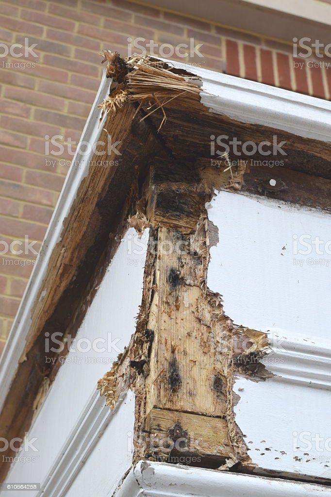 Rotten wood on house porch roof stock photo