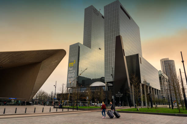 Rotterdam city centre with futuristic buildings near Rotterdam Centraal station. Rotterdam is the second-largest city and a municipality of the Netherlands. stock photo