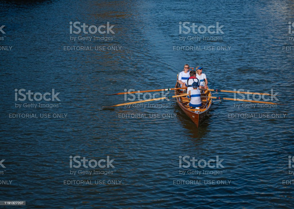 Rotterdam in Summer Two women that a rowing tour on a canal in central Rotterdam on a summer evening Adult Stock Photo