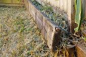 istock Rotting Timber Retaining Wall 1277918054