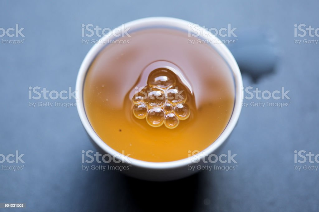 Rou Gui Guan Yin Yan Oolong in teacup filled to the brim - Royalty-free Chinese Tea Stock Photo