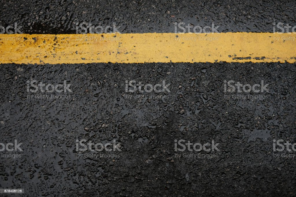 rough black asphalt road and yellow traffic lines ,this image for texture and transport stock photo