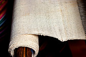 rough cotton fabric on loom in Thailand, raw material plain fabric for natural dyeing