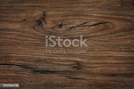 istock Rough dark wood texture 1042454700