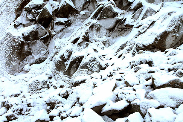 Rough Granite Rock in Snow stock photo