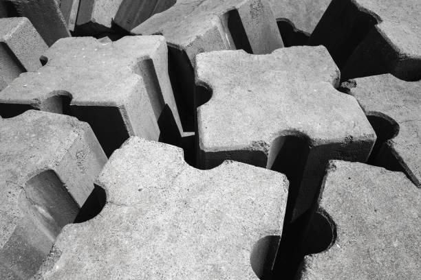 rough gray concrete blocks. breakwater structure - fotos de barragem portugal imagens e fotografias de stock