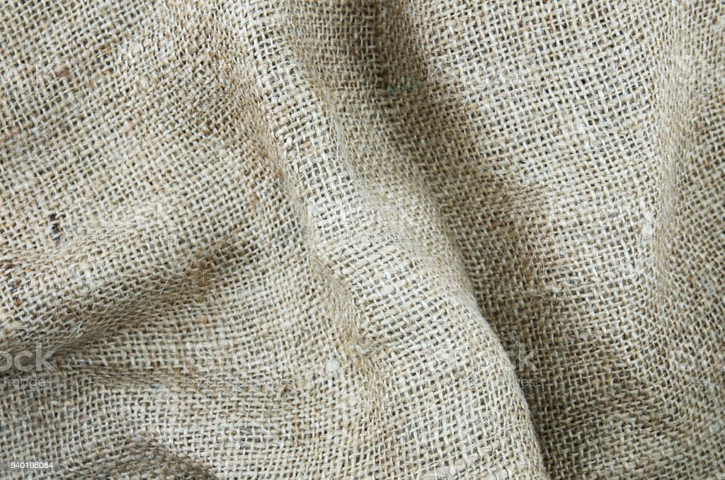 Rough gunny sack or shoe cloth as background for name, caption or title. stock photo