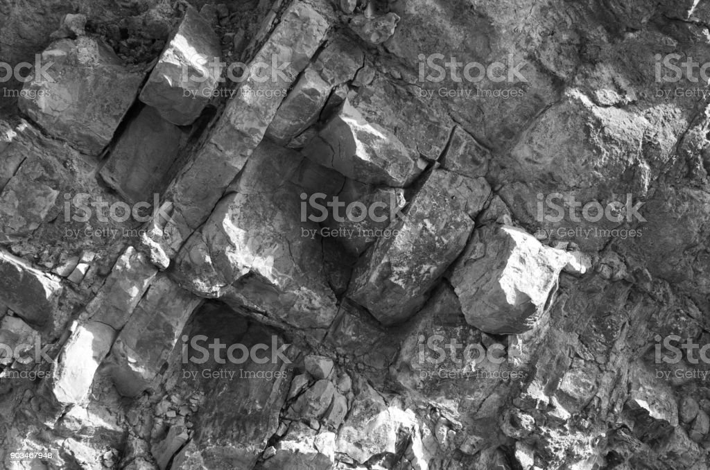 Rough large,gray natural stone, granite wall, background.seamless texture stock photo