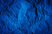 istock Rough navy blue paper texture. Blue crumpled paper texture and background. Close up view of wrinkled navy blue texture made with paper. Deep blue abstract texture and background for designers. 1188920038