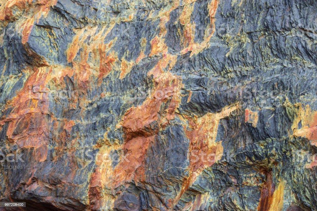 Rough Rusty rock. stock photo