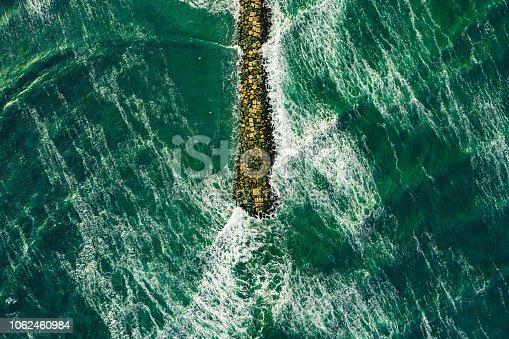 Rough sea aerial view of waves splahing the shore