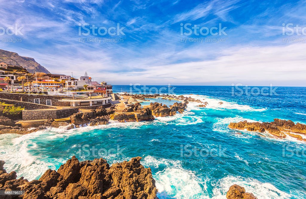 Rough sea and natural volcanic pools at Porto Moniz, Madeira stock photo