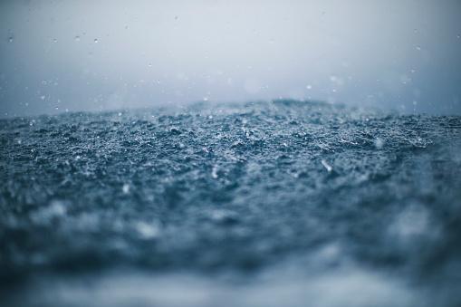 Rough sea and rain drops
