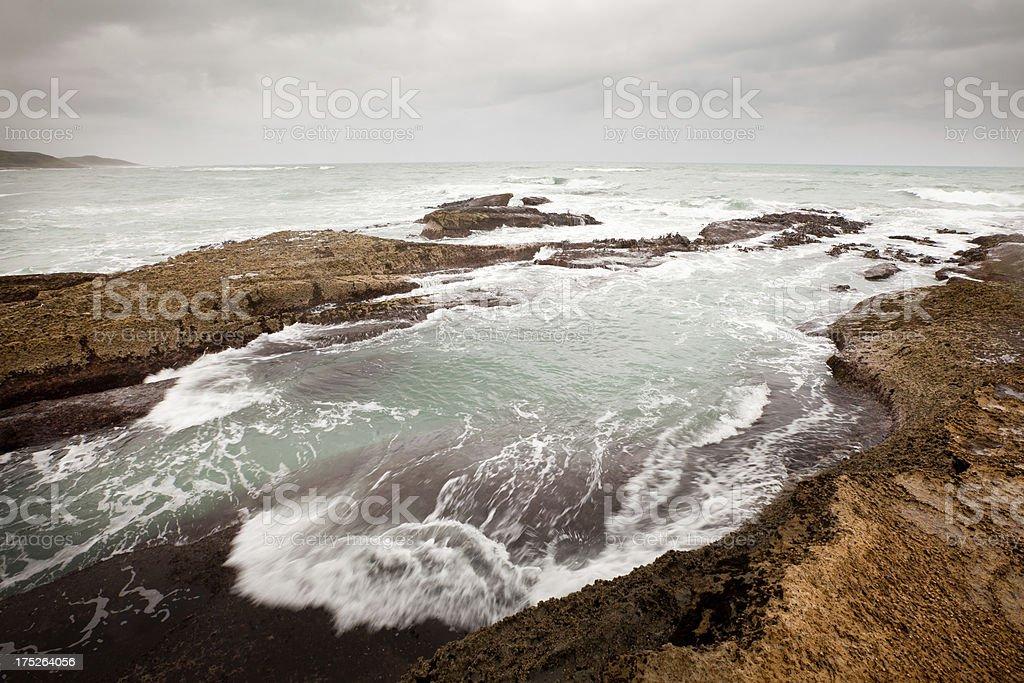 Rough sea surge,West Coast beach, New Zealand royalty-free stock photo