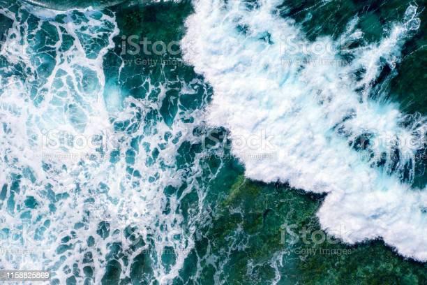 Photo of Rough sea waves splashing near a rocky seabed
