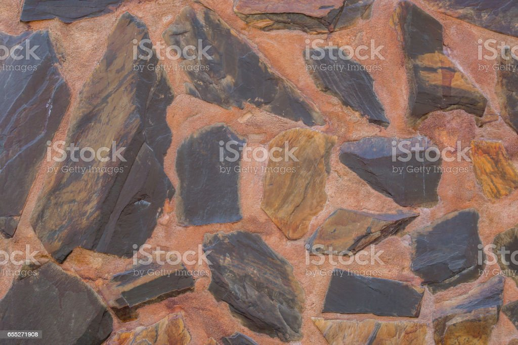 rough stones black and brown stock photo