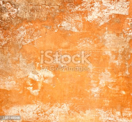 Close-up of a heavily weathered and scratched terracotta surface, taken in Rome, Italy.