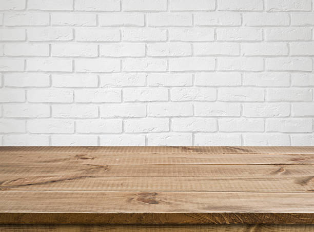 rough wooden texture table over defocused white brick wall background - wood stone bildbanksfoton och bilder