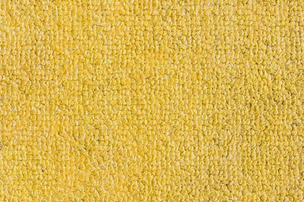 rough yellow doormat background, texture - hausgemachte teppichreiniger stock-fotos und bilder