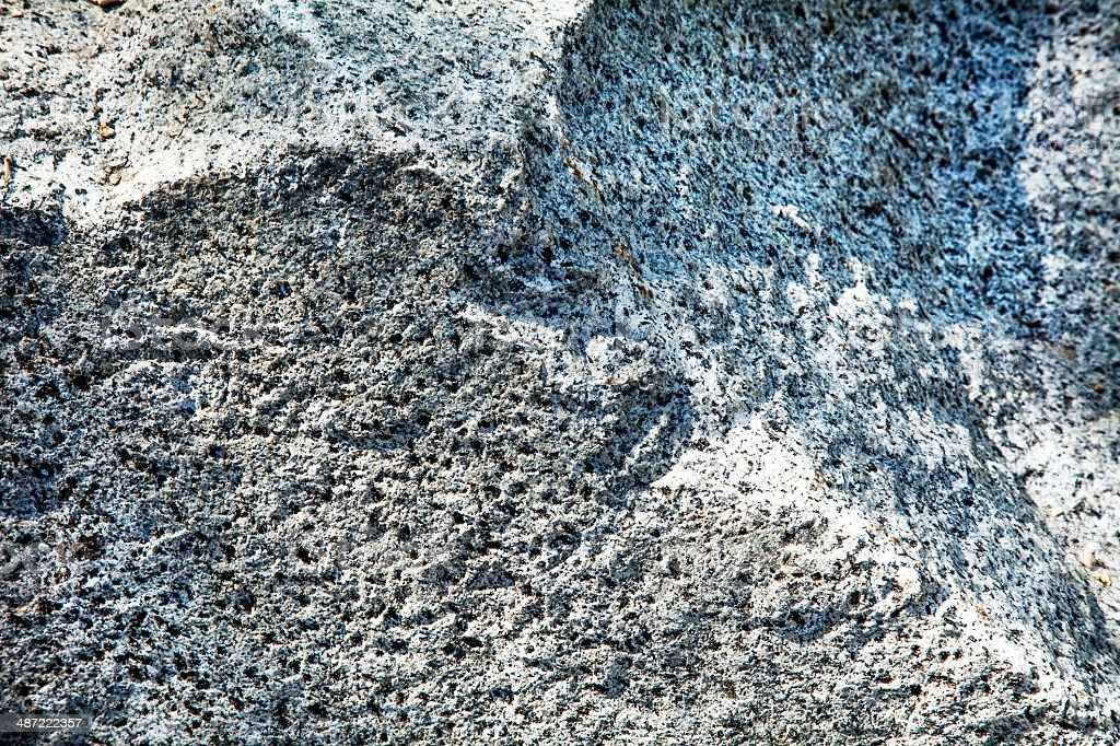 Rough-hewn Gray Granite Texture Under Variegated Sunlight royalty-free stock photo