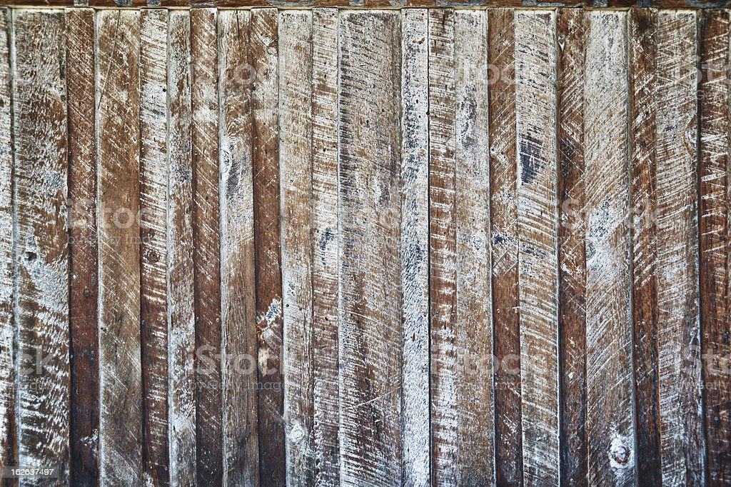 Rough-hewn wood wall background royalty-free stock photo