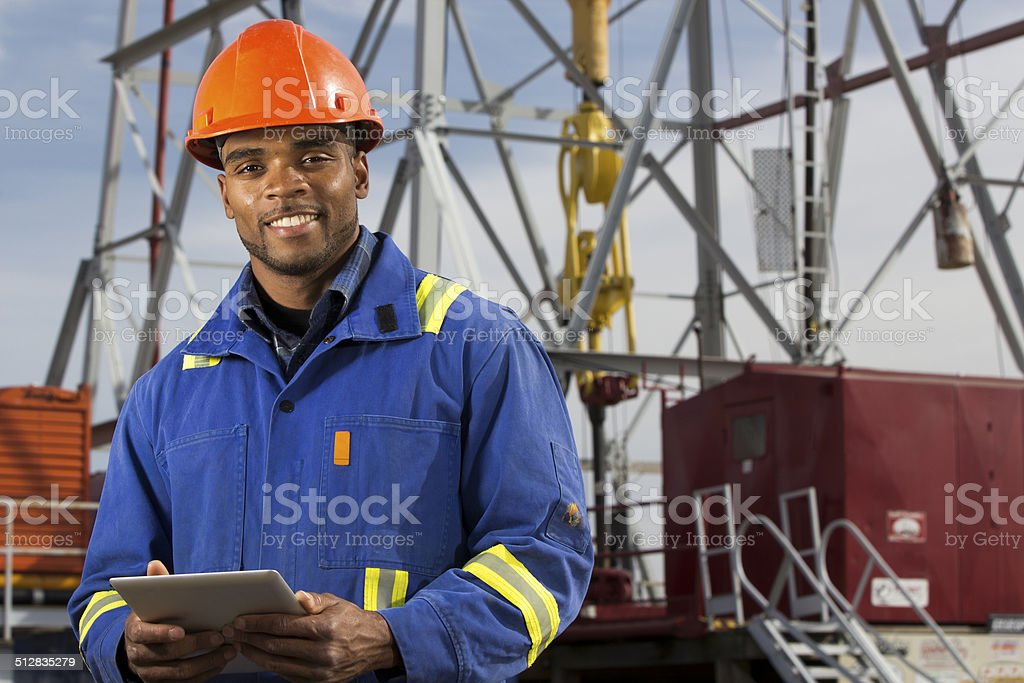 Roughneck and Oil Rig stock photo