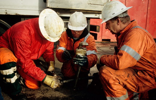 Rig-personnel in the salt-mining industry occupied with wire line tools in Sexbierum, Friesland, the Netherlands on Sept 8, 2008