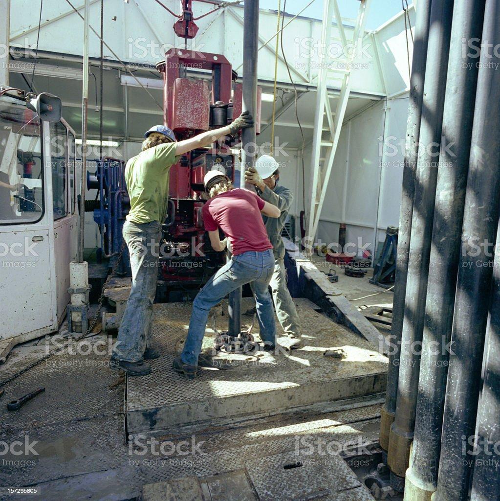 Roughnecks Pulling Pipe stock photo