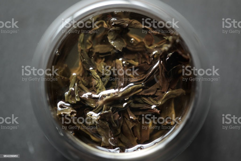 Rougui Yancha cliff tea leaves in a glass teacup - Royalty-free Chinese Tea Stock Photo