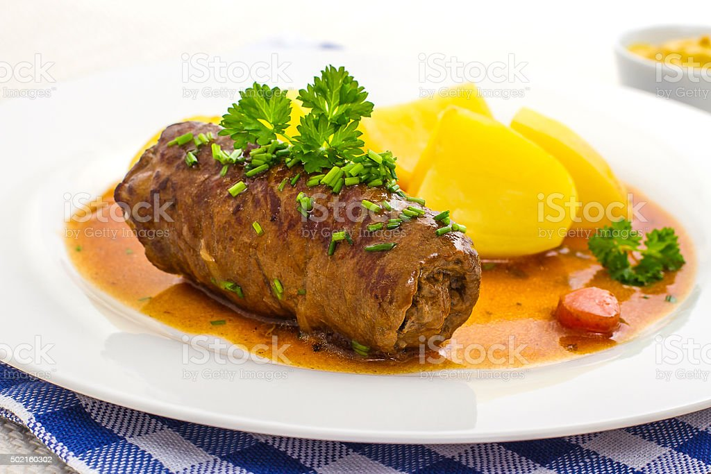 Roulades beef on plate with potato, sauce stock photo