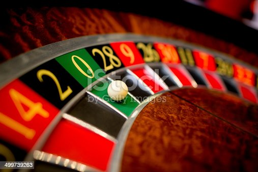 Roulette at the casino with the ball on green zero