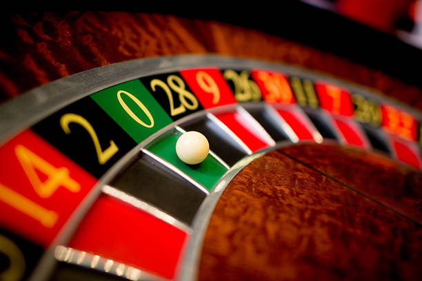Roulette at the casino Roulette at the casino with the ball on green zero game of chance stock pictures, royalty-free photos & images