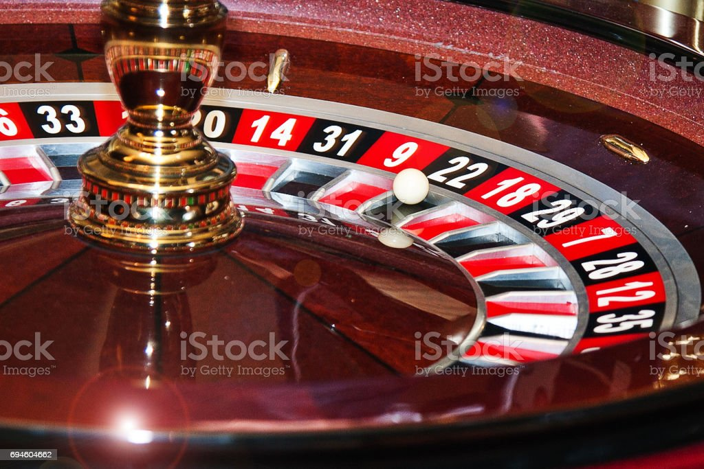 Roulette in the casino. Ball in roulette. Red, black, zero stock photo