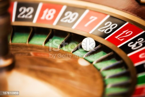 Roulette wheel in casino, close-up on No. 28.