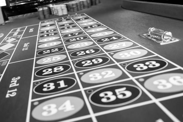 Roulette table in luxury casino. Black and white photo stock photo
