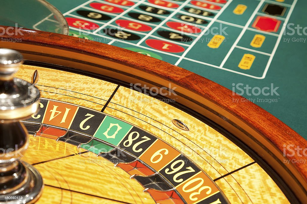 Roulette wheel and table inside casino royalty-free stock photo