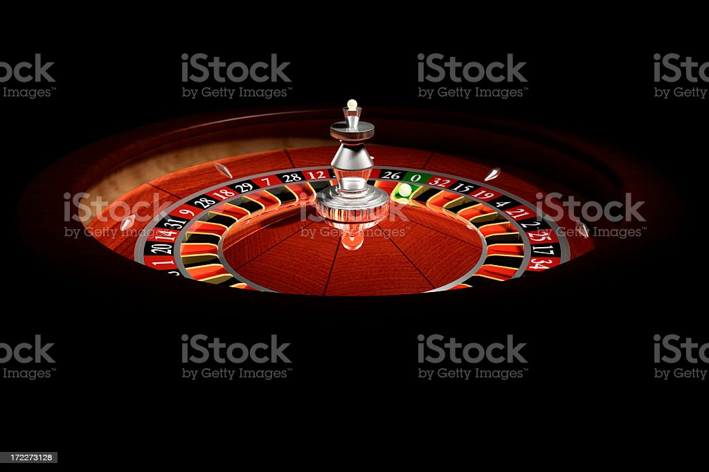 Roulette wheel in a dark casino stock photo