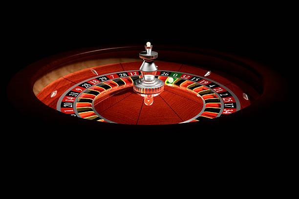 Roulette wheel in a dark casino stock photo