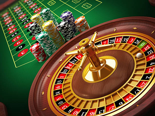 Roulette wheel Roulette wheel and casino chips on the table.Similar images: game of chance stock pictures, royalty-free photos & images