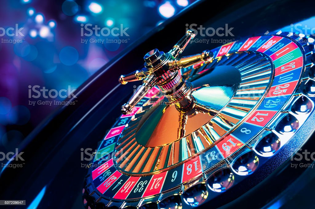 Roulette wheel with a bright and colorful background stock photo