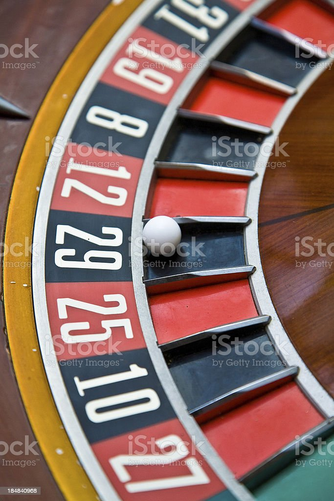 Roulette Wheel with ball on 29 in casino stock photo
