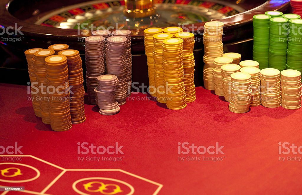Roulette Wheel with Gaming Chips in Play royalty-free stock photo